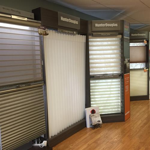 We display dozens of full size window treatments and the control systems available.