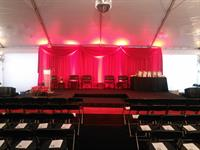 Multi-level Stage with Red Backdrop In Tent