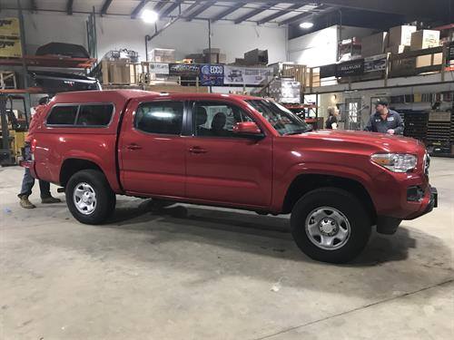Red Toyota Tacoma With New Leer Truck Topper Camper Shell Installed at CPW Truck Stuff