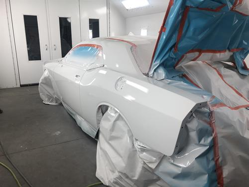 Gallery Image 2016_Dodge_Challenger_RT_Driver_Side_Painted_White.jpg