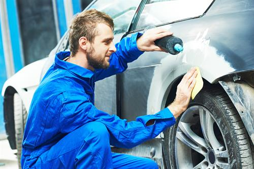 Gallery Image auto_mechanic_worker_applying_washing_car_body_preparing_for_painting_at_automobile_repair_and_renew_service_station.jpg
