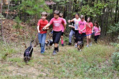 "Children of all ages serve others in the community. Some classes ""adopt"" a non-profit, and here our 5th graders are walking pups at the local shelter."