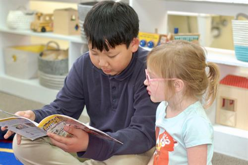 In addition to inspiring a love for books, our Reading Buddies program strengthens bonds between older and younger children.