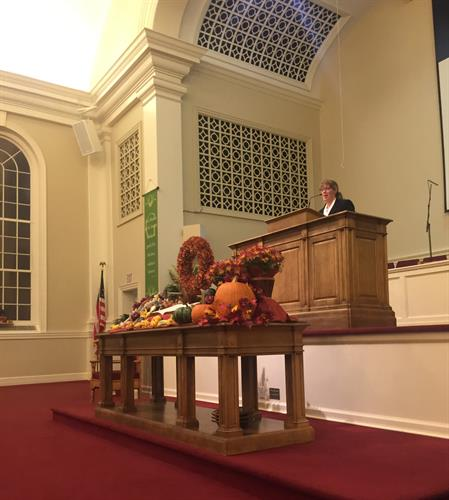 Attorney Katherine S. Charapich, Esq. introducing the keynote speaker Pastor Jonathan Falwell at the Community Thanksgiving Service 2015