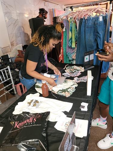 CEO Boss Mom Jasmine packing customer order at Back 2 School Bash Pop Up Shop 7/31/2021