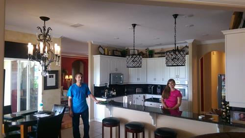 Scott and a happy homeowner.  Beautiful fixtures!