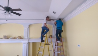 We can install tape lighting around crown molding for a great look.