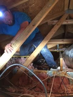 We spend lots of time in attics getting the job done right.