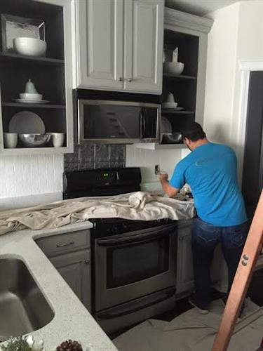 Here is Jorge wiring for a new cooktop.