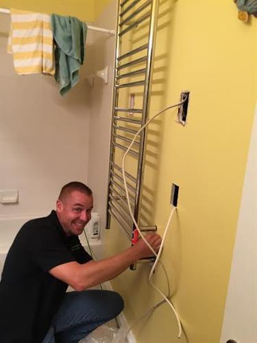 Here's Andrew adding outlets - he's proud of his great work!