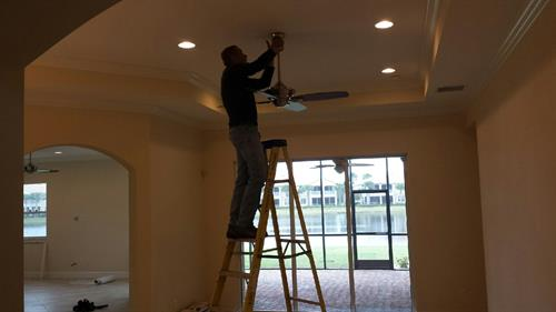 Here's Andrew installing recess can lights.  Great touch and bright lighting.