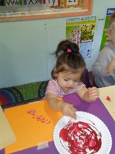 Toddlers painting with a twist.