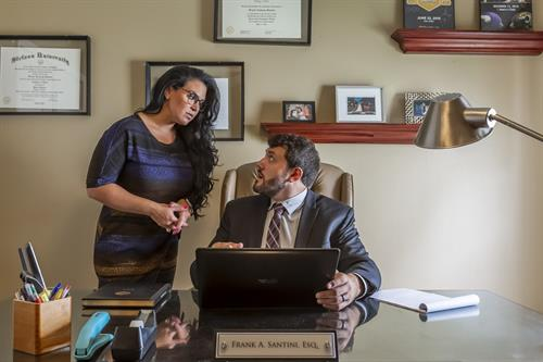 Gallery Image Riverview_Mr._Santini_talking_to_paralegal.jpg