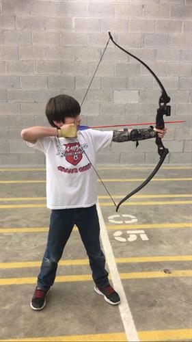 Teaching Archery to Grandson