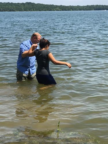 Survivor beng baptized in Percy Priest Lake