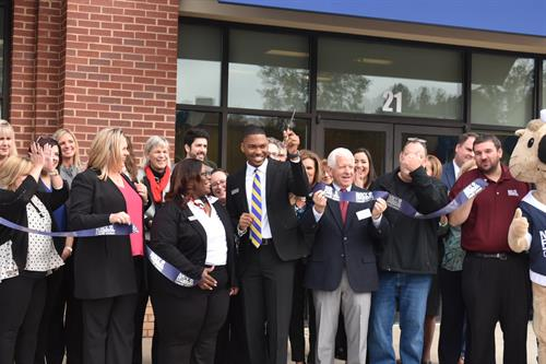 Community supporters joining Branch Manager LaDarius Satterwhite in the official ribbon cutting ceremony.