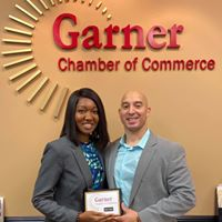 Accepting plaque fro Chamber of Commence