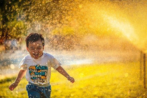 Gallery Image Main_Image-_Boy_in_Sprinkler.jpg