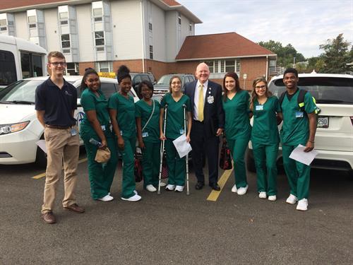 Our team of Marymount Hospital interns meet Hospital President Dr. Dan.