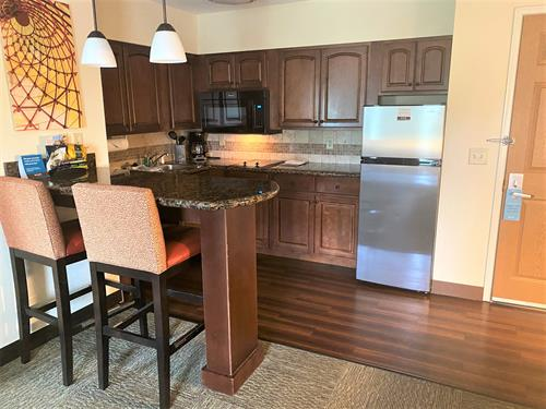 Fully equipped kitchen with breakfast bar in one and 2 bedroom suites