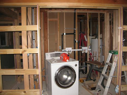 Murphy Job Framing 4 Pocket Doors @ Laundry Room
