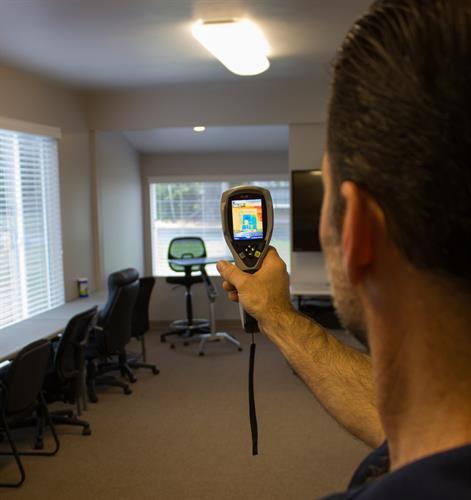 An IR camera can help identify deficiencies in the building envelope.