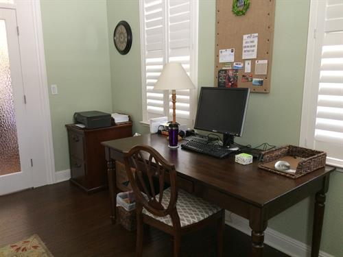 Organized home office with file cabinet After Room Solutions by Paula