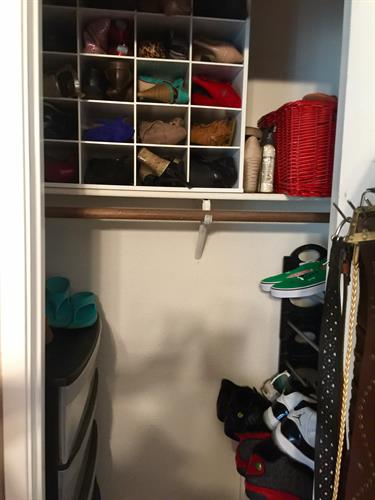 After: better organization for spouses. We took the husband's closet and turned it into a shoe closet. Room Solutions by Paula