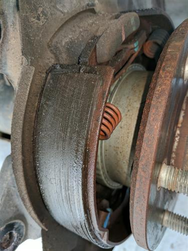 Rear Park Brake Shoes Contaminated With Gear Oil