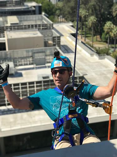 Our CEO, Jake Sindt, going over the edge to support foster children in our communities.