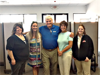 our agents, Charlotte, Carley, Traci, and Sarah with John from Progressive Insurance