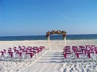 One of our elegant ceremony set-ups with smoothed sand aisle.