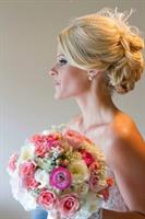 One of out beautiful brides with her gorgeous bouquet.