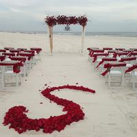 Initial in the sand and full arbor flowers and a chandelier! WOW!