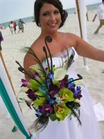 This bride chose peacock feathers in her bouquet! Unique!!!