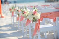 Sashes on the chairs and flowers on the aisle! Touch of Class!