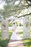 Our white antique doors make a sweet entrance