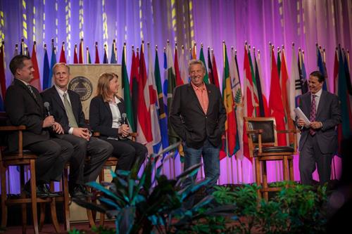 Leading the Leadership Award Ceremony with colleagues an John Maxwell