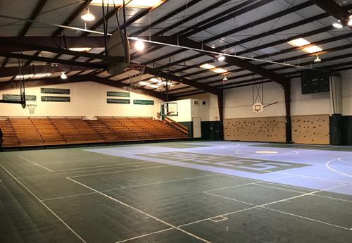 A spacious gymnasium for indoor sports, games and special activities.