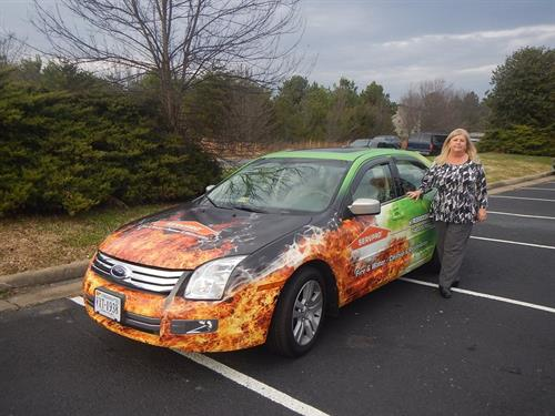 Patsy Geel and one of our Marketing Vehicles