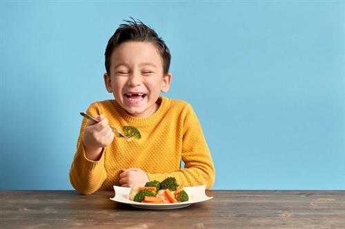 Gallery Image Boy_in_yellow_eating_vegetables.jpg