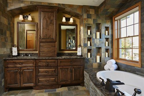 Master bath with extensive and creative use of stone tile throughout with heating floors.