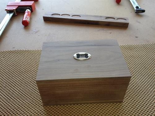 Custom box with inlaid dog tag to hold ashes of beloved pet