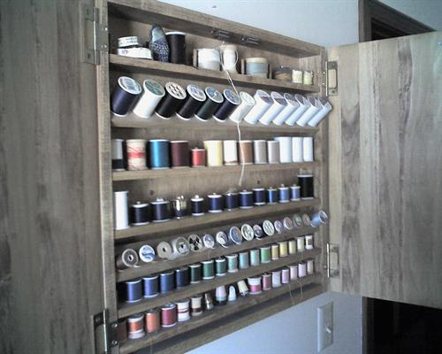 Thread cabinet, inside with tilting shelves