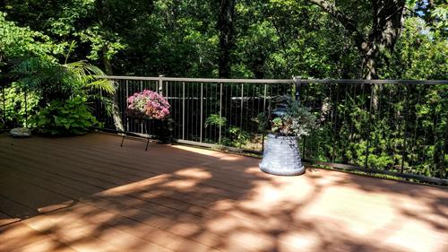 Vertical cable railing and PVC easy-to-maintain decking and handrail