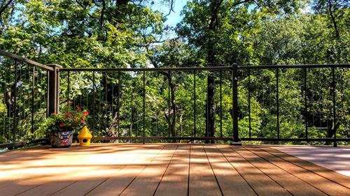 gorgeous lake view deck utilizing vertical cable railing for a viewing friendly handrail.