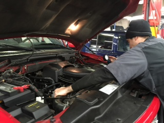 Checking Coolant Pressure to keep customer car in great working order.