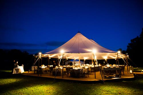 Evening reception under a sail cloth tent
