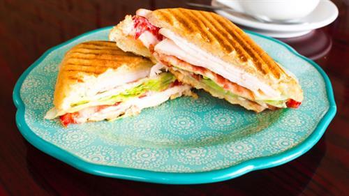 Turkey Club Panini (turkey, bacon, tomatoes, lettuce, swiss cheese & mayo on ciabatta bread)
