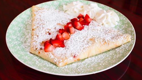 French strawberry cheesecake (sweetened cream cheese, fresh strawberries, whipped cream and powdered sugar)